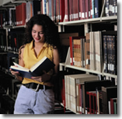 woman reading book, library, bookshelf