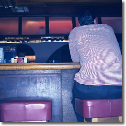 man sitting at bar