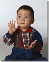 infant boy clapping