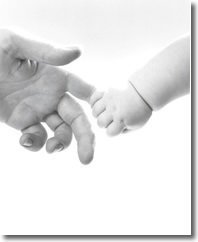 baby holding adults finger